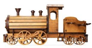 Hölzernes Modell des Zugs lokalisiert auf dem weißen Hintergrund Stockbild