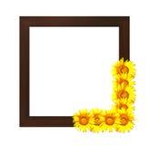 Hölzernes photoframe verziert mit Sonnenblume Lizenzfreie Stockfotografie