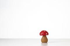 Hölzernes Pilzspielzeug Stockbild