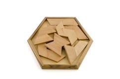 Hölzernes Puzzlespiel lokalisiert auf Weiß Stockbilder