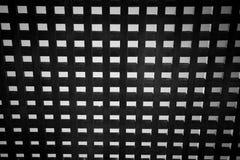 Hölzernes quadratisches Gitter - abstraktes Schwarzweiss Stockfotografie