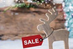 Hölzernes Ren auf Weihnachtsverkauf Lizenzfreie Stockfotografie