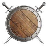 Hölzernes rundes Schild und zwei gekreuzte Klingen Stockfoto