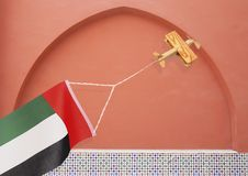 Hölzernes rustikales Flugzeug mit Staatsflagge UAE Lizenzfreie Stockfotos