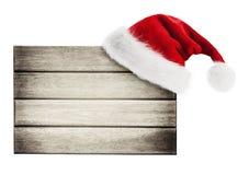 Hölzernes Schild mit Weihnachtshut Stockbilder