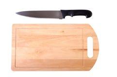 Hölzernes Schneidebrett und Messer Stockbild