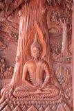 Hölzernes Schnitzen Buddhas in Thailand Stockbild