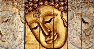 Hölzernes Schnitzen des Gesichtes des Lords Buddhas Stockfotos