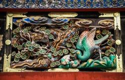 Hölzernes Schnitzen des Pfaus, Toshogu-Schrein, Präfektur Tochigi, Japan stockfotografie