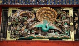 Hölzernes Schnitzen des Pfaus, Toshogu-Schrein, Präfektur Tochigi, Japan lizenzfreies stockbild