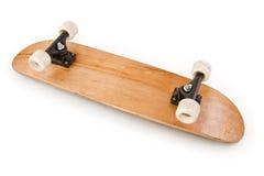 Hölzernes Skateboard gedreht Stockfotografie