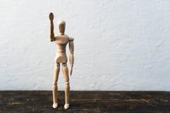 Hölzernes Spielzeug im Bild eines Mannes auf einem weißen Hintergrund Stockfotografie