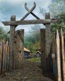 Hölzernes Tor zu einem mittelalterlichen Dorf stock abbildung