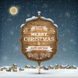 Hölzernes Weihnachtsschild auf dem Schnee Lizenzfreies Stockfoto