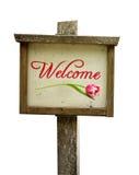 Hölzernes Willkommensschild mit einer Tulpe lizenzfreie stockbilder