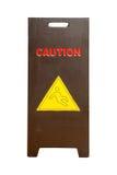 Hölzernes Zeichen, welches das Warnen des nassen Fußbodens der Achtung zeigt Lizenzfreie Stockbilder