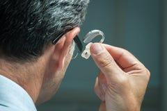 Hörapparat arkivbild