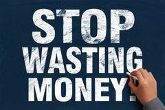 Hören Sie auf, Geld zu vergeuden Stockfotografie