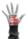 Hören Sie auf, Geld zu vergeuden Stockfotos