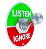 Hören Sie gegen ignorieren - Kippschalter Stockbilder