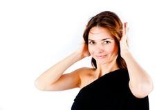 Hören Sie kein Übel - die junge Frau, die ihre Ohren abdeckt Stockbild