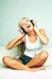 Hören Sie Musik Stockbild
