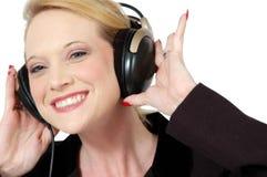 Hören Sie zu den Kopfhörern Stockbild