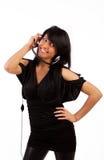 Hörende Musik des entzückenden Brunette Lizenzfreie Stockbilder