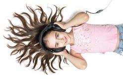 Hörende Musik des jungen Mädchens Lizenzfreies Stockfoto