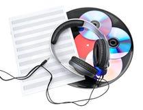 Hörlurar, CD och vinylrekord Royaltyfria Bilder