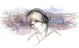 hörlurar lyssnar manmusik till Arkivfoton