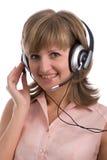 hörlurar med mikrofonkvinna Arkivfoto