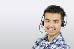 hörlurar med mikrofonman Fotografering för Bildbyråer