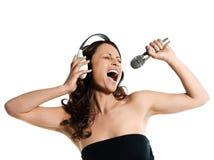 hörlurarmikrofonen syndar kvinnan Royaltyfri Fotografi