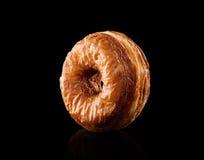 Hörnchen- und Donutmischung lokalisiert auf Schwarzem Lizenzfreies Stockbild