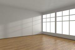 Hörnet av vitt tömmer rum med stora fönster Arkivbild