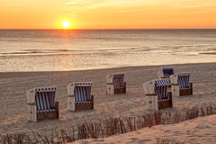 Hörnum, Sylt - beach chairs at North Sea in sunset Stock Image