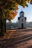 Hösten landskap med kyrkan royaltyfria foton