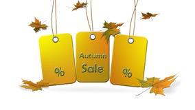 Höstförsäljning - hänga undertecknar med procent- och höstsidor Royaltyfri Foto