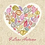 Höstkortdesign med hjärta som göras av sidor Arkivfoto