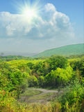 Höstliggande med den färgrika skogen royaltyfria foton