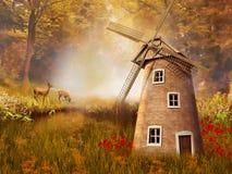 Höstligt landskap med en väderkvarn Arkivfoton