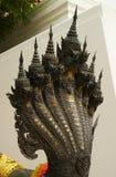 Hövdad skulptur för orm sju Arkivbild