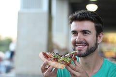 Hübsche Fleisch fressende Pizza Stockfoto