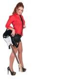 Hübsche Frau in den schwarzen kurzen Hosen, die mit Gitarre aufwerfen Lizenzfreie Stockfotos