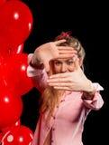 Hübsche Frau in der Bluse mit roten Ballonen Lizenzfreie Stockbilder