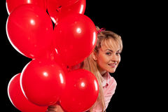 Hübsche Frau in der Bluse mit roten Ballonen Stockbild