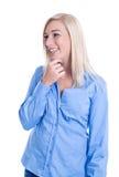 Hübsche Frau, die oben schaut, berührend denkend und sie  Lizenzfreie Stockbilder