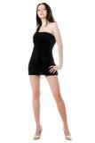 Hübsche Frau im schwarzen Kleid Stockbild