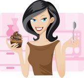 Hübsche Frau mit Herzchenkleinem kuchen Stockbild